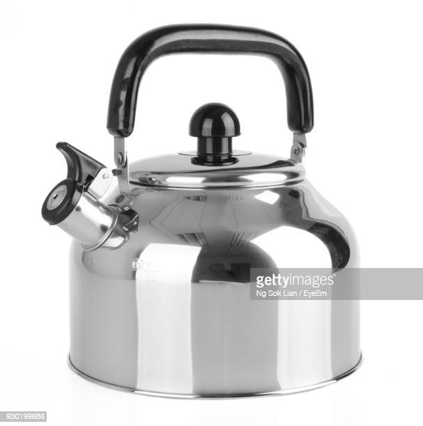 Close-Up Of Tea Kettle Against White Background