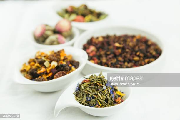 close-up of tea leaves in bowl - dried tea leaves stock photos and pictures