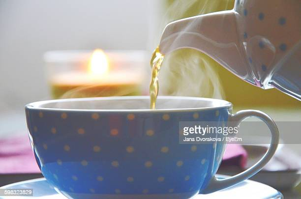 Close-Up Of Tea Pouring In Cup