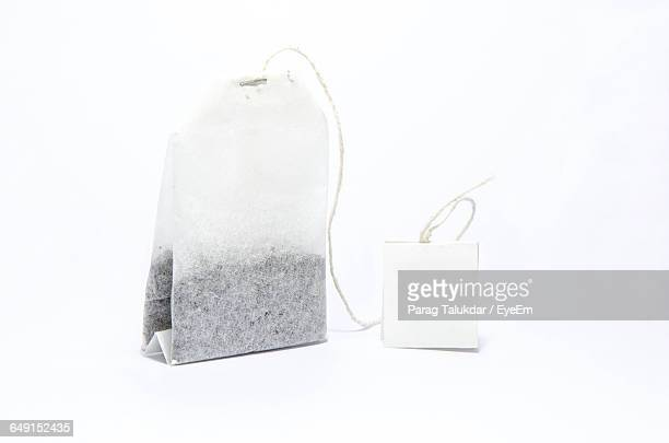 Close-Up Of Teabag On White Background