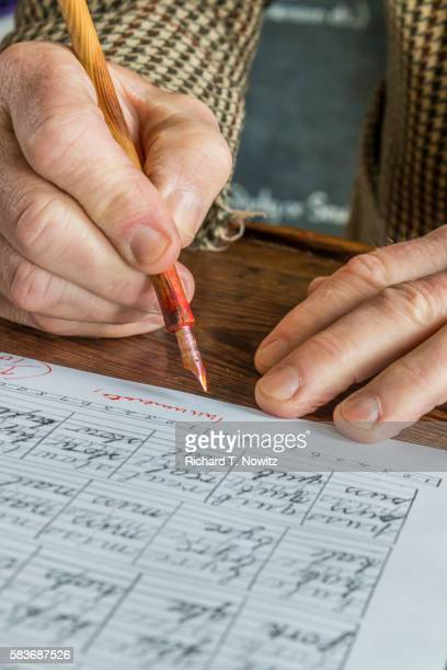 Close-up of teacher correcting papers
