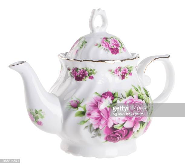 close-up of teapot against white background - ティーポット ストックフォトと画像