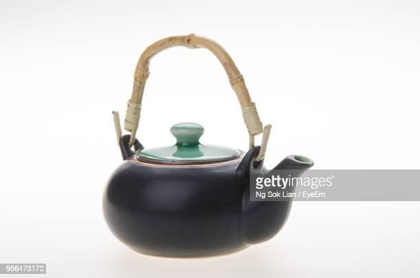 Close-Up Of Teapot Over White Background