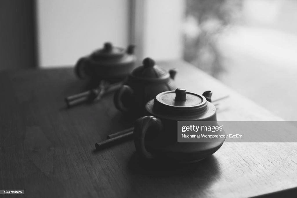 Close-Up Of Teapots On Table : Stock Photo