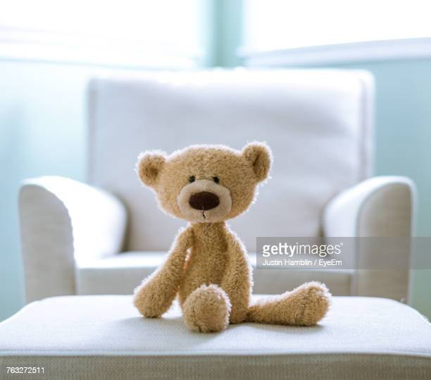close-up of teddy bear on sofa at home - stuffed toy stock pictures, royalty-free photos & images