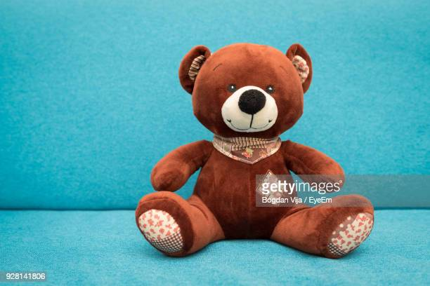 close-up of teddy bear on sofa - stuffed toy stock pictures, royalty-free photos & images