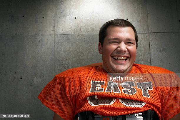 Close-up of teenage (16-17) American football player laughing