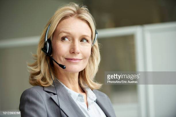close-up of telecaller with headset - hands free device stock pictures, royalty-free photos & images