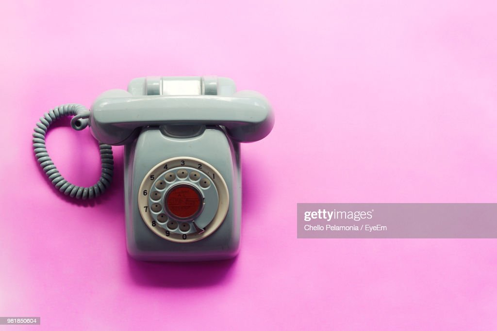 Close-Up Of Telephone On Pink Background : Stock Photo
