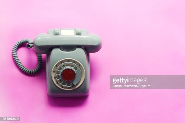 Close-Up Of Telephone On Pink Background