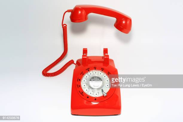 Close-Up Of Telephone On Red Background