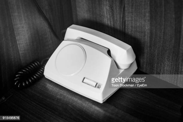 Close-Up Of Telephone On Table