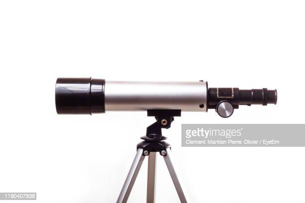 close-up of telescope against white background - telescope stock pictures, royalty-free photos & images