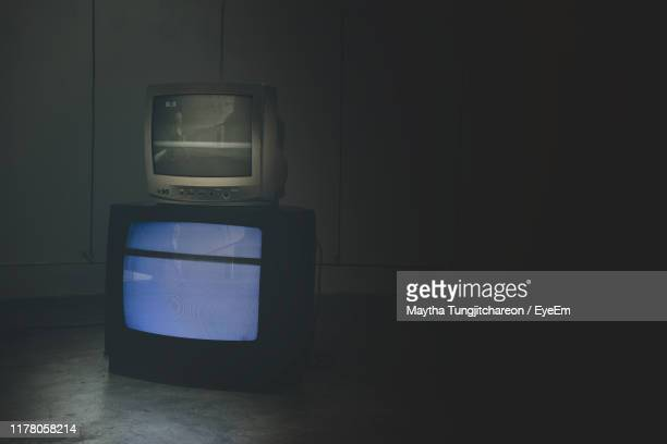 close-up of television sets on floor at home - darkroom stock pictures, royalty-free photos & images