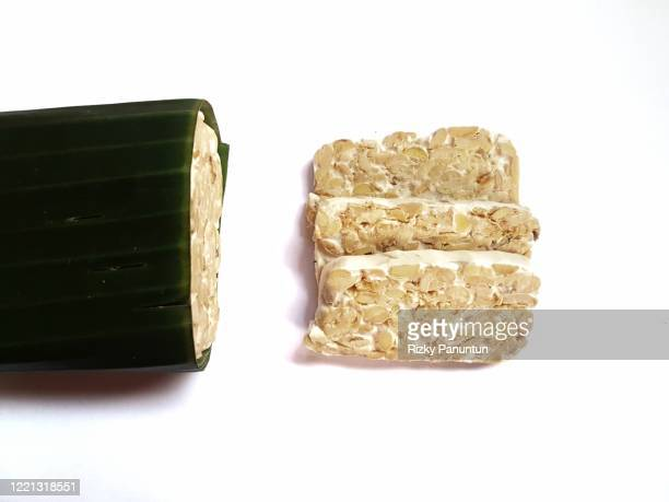 close-up of tempeh on white background - meat substitute stock pictures, royalty-free photos & images