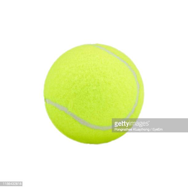 close-up of tennis ball against white background - tennis ball stock pictures, royalty-free photos & images