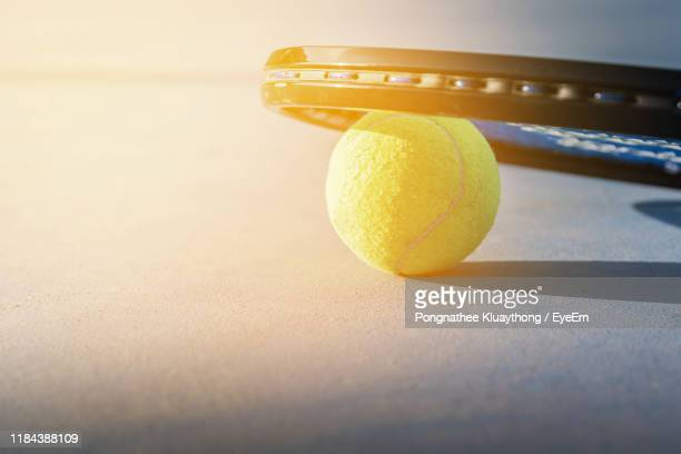 close-up of tennis ball and racket - tennis racquet stock pictures, royalty-free photos & images