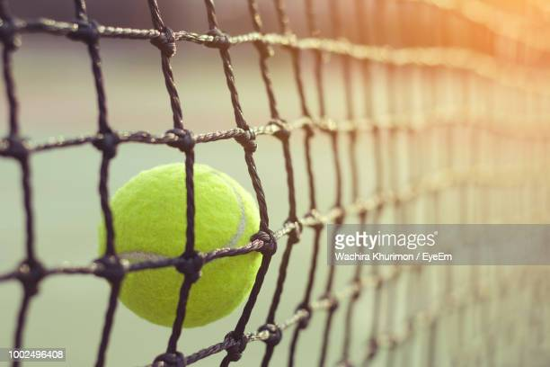 close-up of tennis ball hitting net - netting stock pictures, royalty-free photos & images