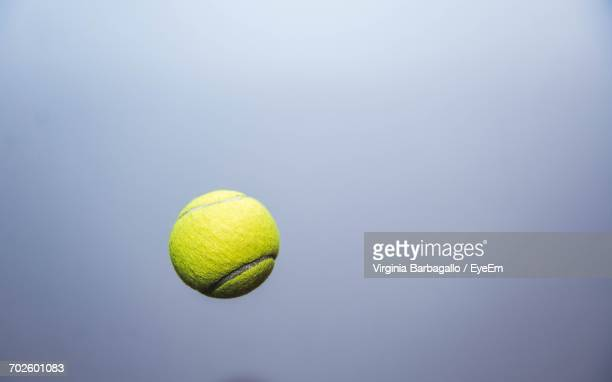 close-up of tennis ball mid-air - tennis ball stock pictures, royalty-free photos & images