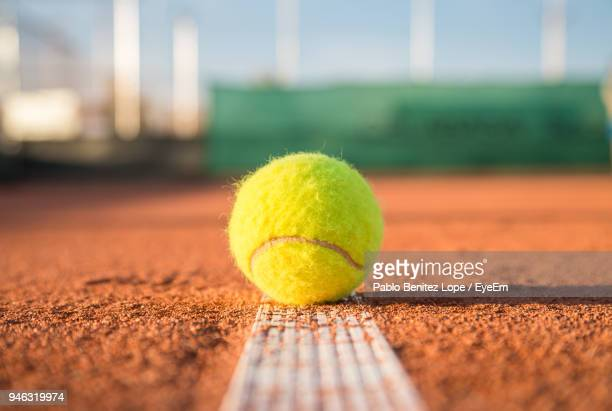 close-up of tennis ball on field - tennis ball stock pictures, royalty-free photos & images