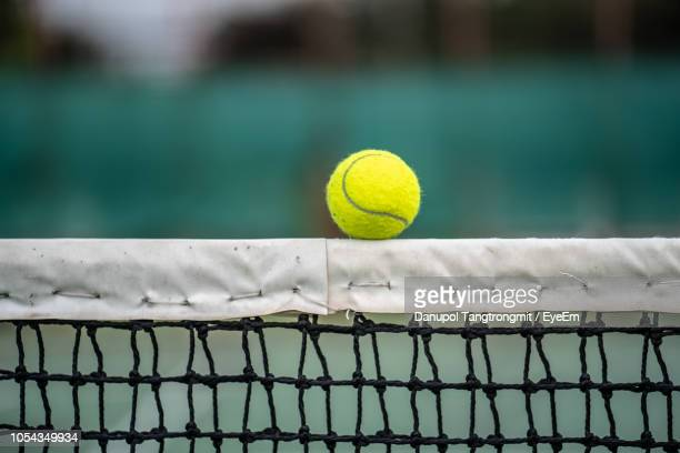 Close-Up Of Tennis Ball On Net