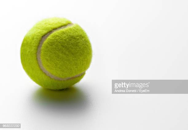 close-up of tennis ball on white background - sports ball stock pictures, royalty-free photos & images