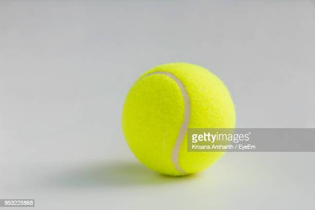 close-up of tennis ball on white background - tennis ball stock pictures, royalty-free photos & images