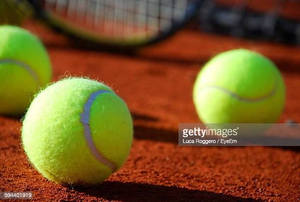 Close-Up Of Tennis Balls On Field