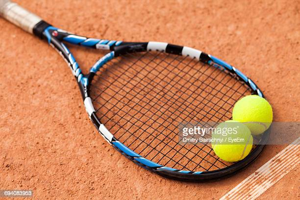 Close-Up Of Tennis Balls On Racket