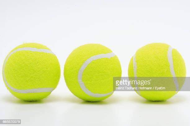 close-up of tennis balls on white background - tennis ball stock pictures, royalty-free photos & images