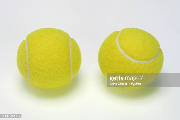 close-up of tennis balls over white background - テニスボール ストックフォトと画像