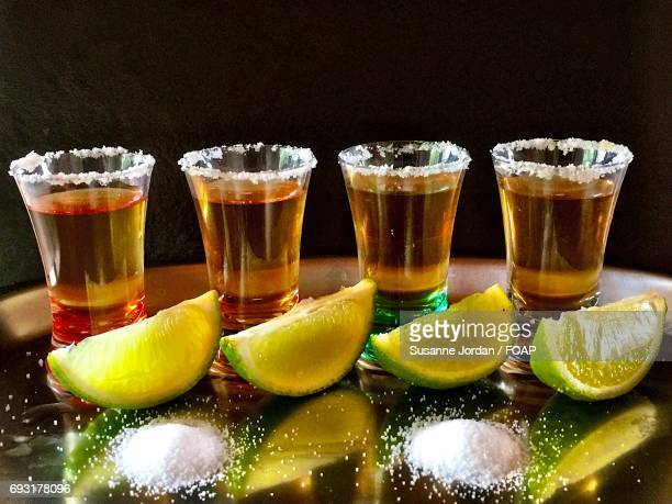 Close-up of tequila shots on table
