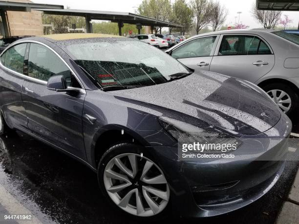 Closeup of Tesla Model 3 electric car from Tesla Motors on a rainy day in Dublin California April 6 2018
