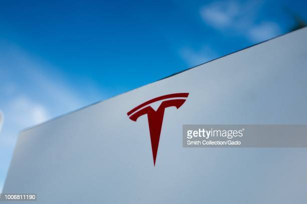 Close-up of Tesla Motors logo against a bright blue sky in Pleasanton, California, July 23, 2018.