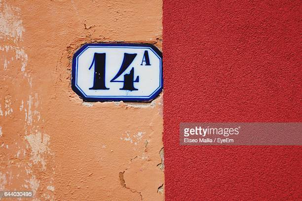 close-up of text and number on wall - number 14 stock photos and pictures