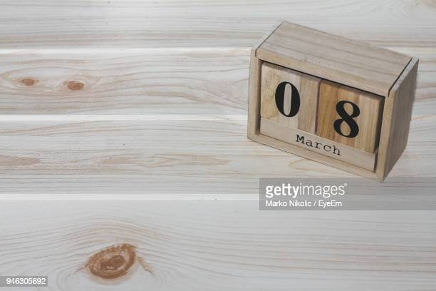 Close-Up Of Text And Number On Wooden Block