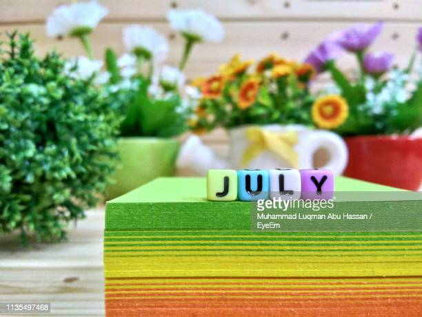 close-up of text blocks on adhesive notes - july stock pictures, royalty-free photos & images