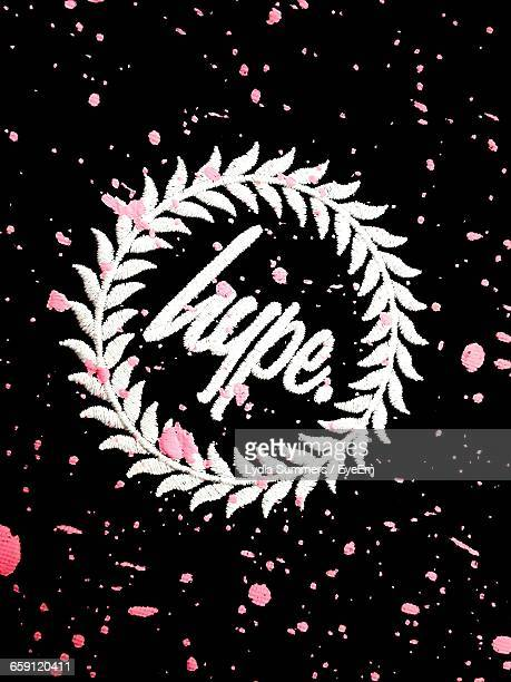 close-up of text embroidery on black fabric - embroidery stock pictures, royalty-free photos & images
