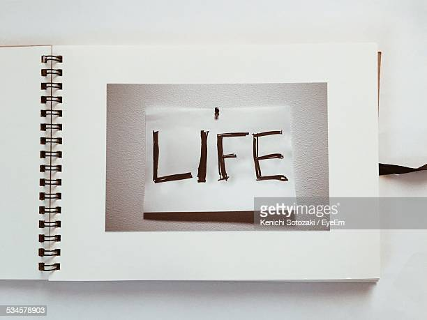 close-up of text in photo album - photo album stock photos and pictures