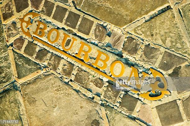 close-up of text on a wall, bourbon street, new orleans, louisiana, usa - french quarter stock photos and pictures