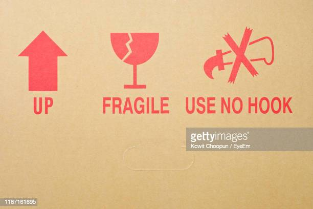 close-up of text on cardboard - fragility stock pictures, royalty-free photos & images