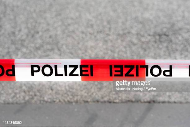 close-up of text on cordon tape against road - man made space stock pictures, royalty-free photos & images