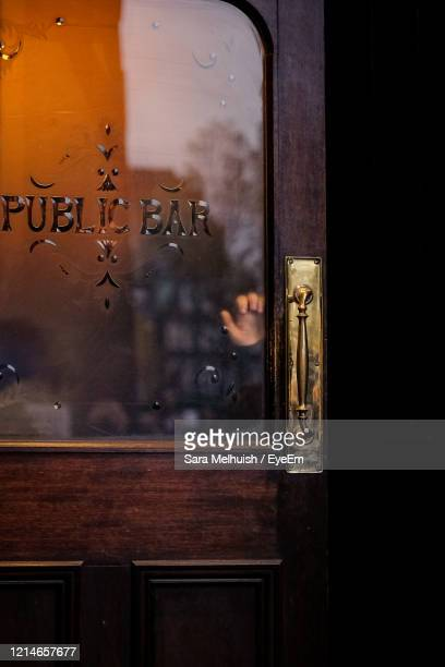 close-up of text on glass door - pub stock pictures, royalty-free photos & images