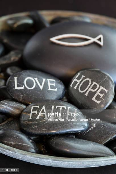 Close-Up Of Text On Pebbles