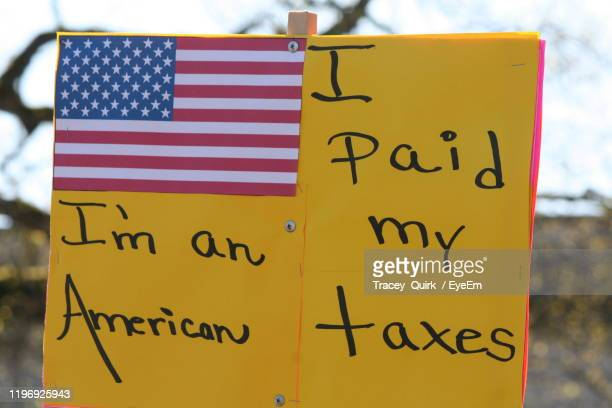 close-up of text on protest sign - impeachment photos stock pictures, royalty-free photos & images