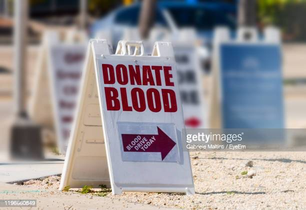 close-up of text on road sign - blood donation stock pictures, royalty-free photos & images