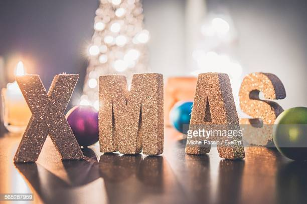 Close-Up Of Text On Table During Christmas At Home