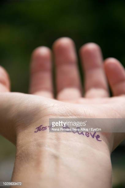 close-up of text on wrist - human joint stock pictures, royalty-free photos & images