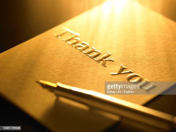 close-up of thank you card on table - thank you stock pictures, royalty-free photos & images