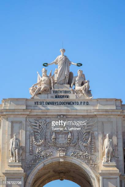close-up of the 18th century arco da rua augusta, triumphal arch gateway, in baixa district in lisbon, portugal, on a sunny day. - rua stock pictures, royalty-free photos & images
